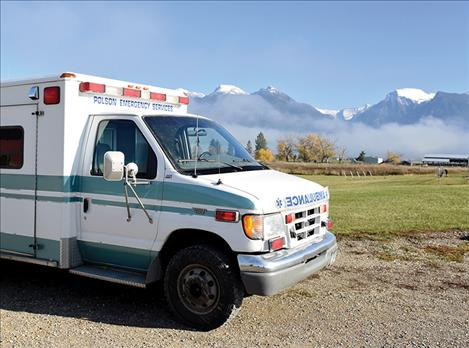 Mission Ambulance crew uses a Polson Ambulance vehicle until Mission Ambulance can obtain affordable insurance.