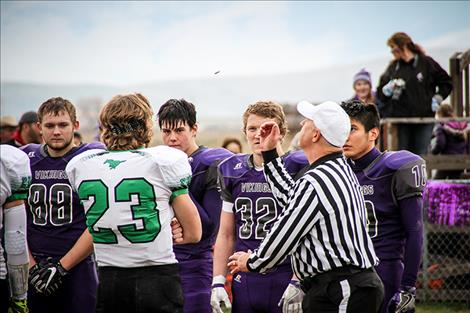 Teams lock stares during the coin toss.