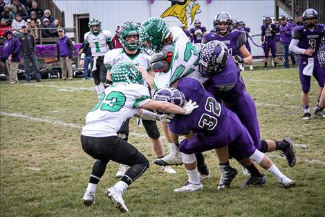 Vikings Jared Doty and Trent Dennison put a hit on Dillon runningback Jake Knack, nearly tearing off his jersey during Saturday's State Championship game in Charlo.