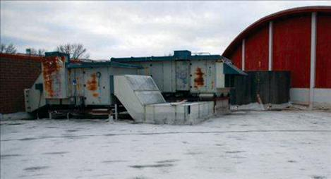 Heating units on the roof of Polson High School show rusted areas and must be removed before the roof can be replaced.