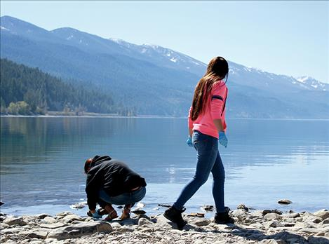 Students scour the Blue Bay shoreline last April for evidence of mussels. None was found.