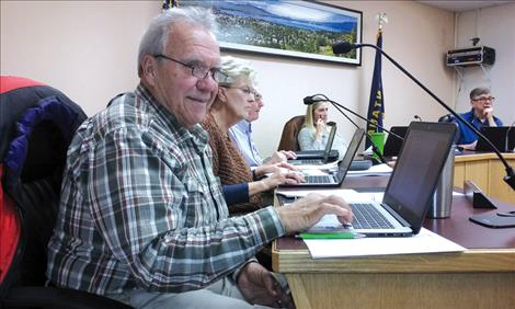 Commissioner Lou Marchello checks out his new Chromebook during the Nov. 21 Polson City Commission meeting.
