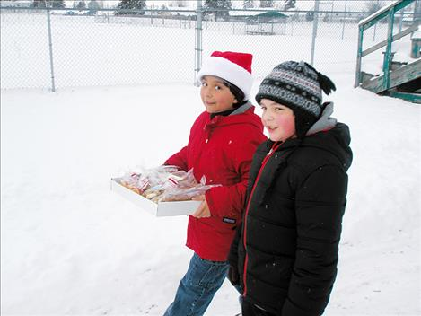 Students walk with cookies to the CSKT law enforcement building on Friday, Dec. 16.