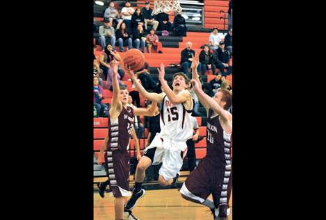 Junior Tim Woll goes up for two points during Friday's game.
