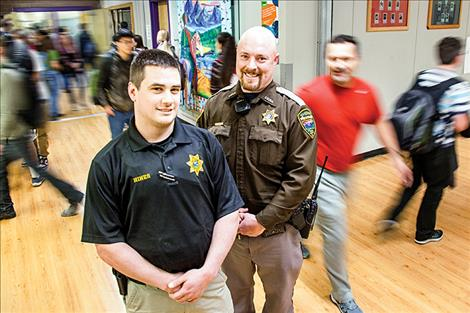 Polson High graduates Brian Hines, left, and Nate Lundeen keep halls safe as School Resource Officers.