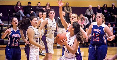 Lady Pirate Olivia Perez drives the lane against Wildkat defenders on Saturday.