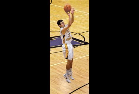 Polson Pirate Hayden Congdon shoots for three during a game earlier this season.