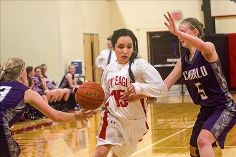 Two Eagle's Naomi Stevens slips past Lady Vikings' defense
