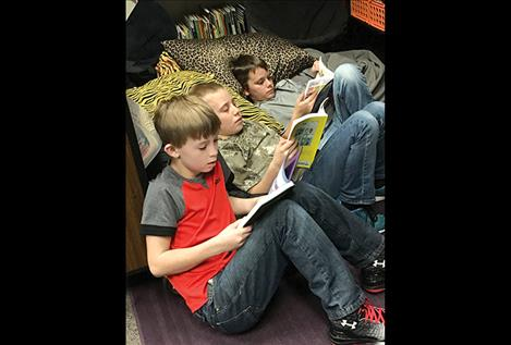 Dayton Elementary students Ryder Judd, Dawon Schmeusser and Slade Massie reads books courtesy of the West Shore Library.
