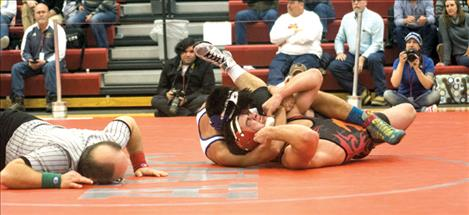 Mission's Trent Dennison wrestles in the championship round, winning by decision.