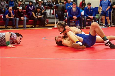 Chiefs' Noah Cheff wins his weight class with a pin