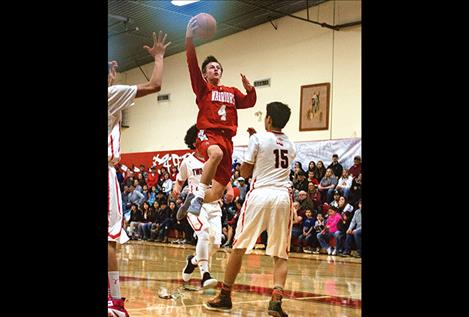 Warriors' Phillip Malatare soars above the Eagles' defense.