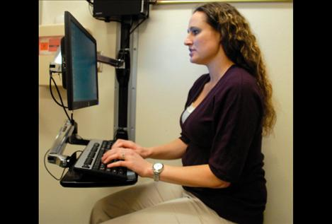 Health care providers use computers in exam rooms to enter information on a patient's visit. The computers sit so providers can talk to patients face-to-face.