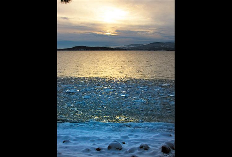 Sunrays cast an icy glow on the surface of the East Shore of Flathead Lake.