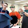 Science teacher Phil Engeldrum helps Ronan High School freshmen Evan Denny and Blaise Wikstrom test salinity values of different types of water.