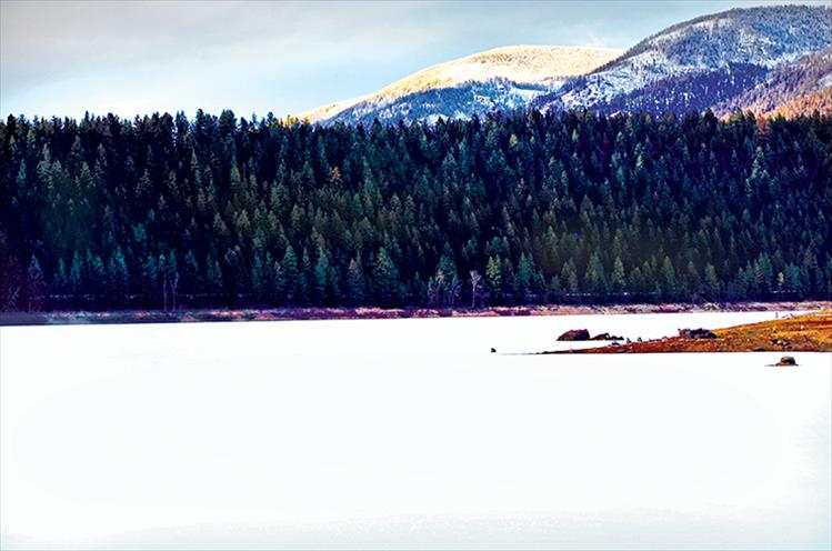 Snow covers the Mission Reservoir