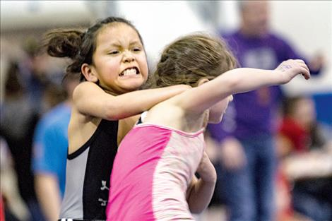 Little grapplers show off their best game faces.