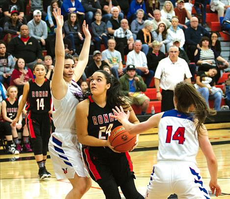 Ronan's Alicia Camel drives the lane during a divisional game.