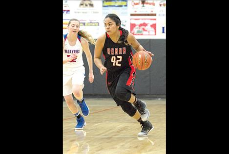 Maidens' Lee Camel brings the ball down court during a divisional game.