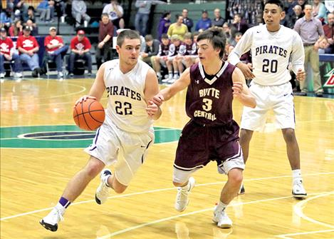Polson Pirate Tanner Wilson cuts to the basket during the game against Butte Central.