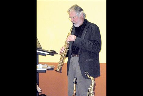 Wilbur Rehmann, a jazz musician from Helena, plays the saxophone at last week's Montana Humanities event at North Lake County Public Library.