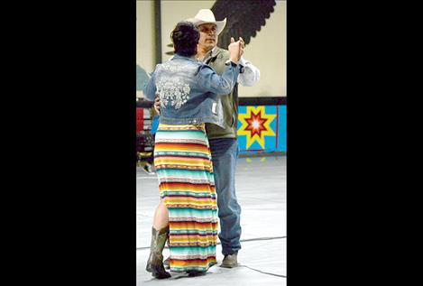 """Cher and Leon Stewart circle the floor during the """"Ladies' Choice"""" dance."""