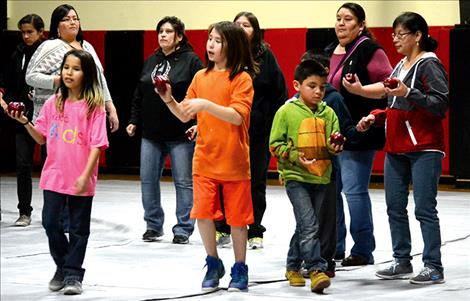 Two Eagle River families participate in the Apple Dance, inviting life-giving friendship.