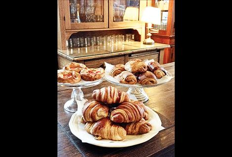 Croissants, savory tomato and goat cheese puffs, and pain au chocolat are among the variety of fresh specialty pastries baked daily at the cafe.