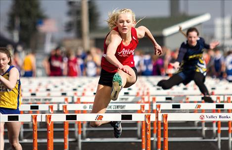 Arlee's Carly Hergett competes in the 110 hurdles, placing first with a time of 16.78.