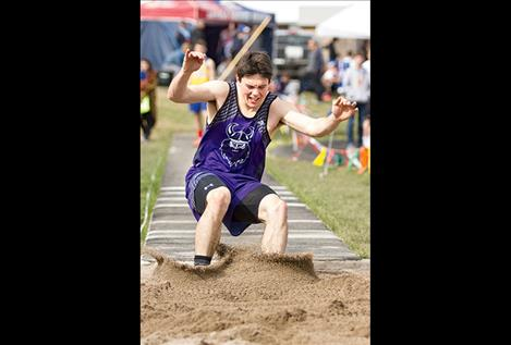 Mission's Flint McPherson competes in the long jump.