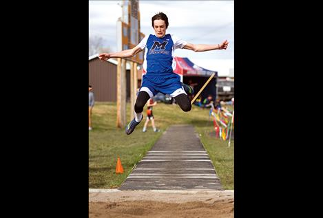 Mission's Flint McPherson leaps in the long jump.