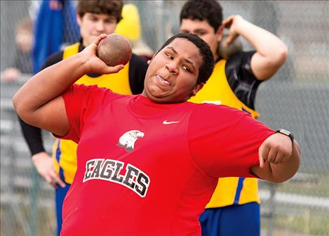 Two Eagle's Zion Bolen competes in shot put.
