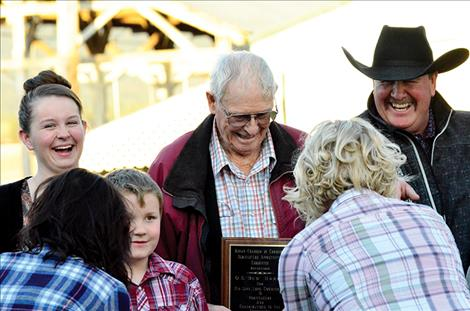 Bud Harris shares his Ronan Chamber of Commerce Agriculture Appreciation award with his family.