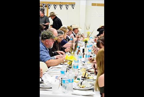 Farmers and ranchers enjoy an appreciation dinner put on by the Ronan Chamber of Commerce.