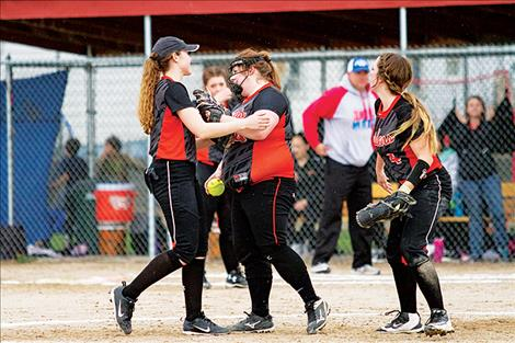 Maidens' Marissa Mock and teammates celebrate her 1-3 double play.