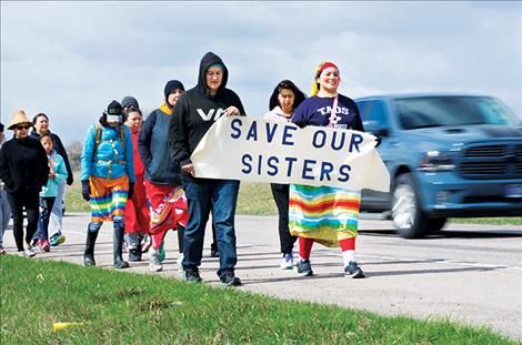 arita Growing Thunder leads a walk across the Flathead Indian Reservation to give missing or murdered indigenous women a voice.