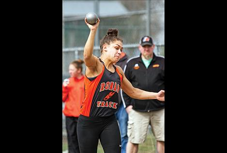 Ronan Maidens' Micalann McCrea competes in the shot put during the Ronan Invitational on April 1. McCrea won three events at the Bigfork Invitational last Saturday.