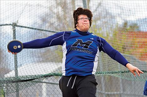 Mission's Michael Durglo throws for 126 feet.