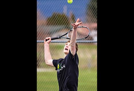 Ronan's Bailey Moss serves during his match.