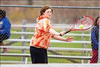 Spring downpour halts tennis matches