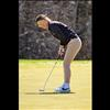 Maidens' Brooklyn Olson lines up her putt.