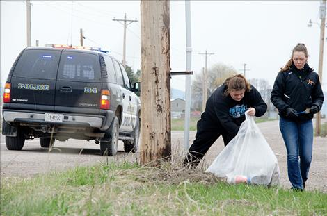 Ronan High School students clean up the town.