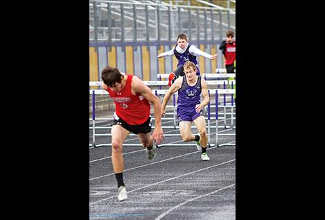 Toby Odom competes in the hurdles during a recent track event.