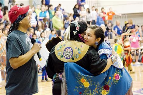 Salish language teacher Rose Bear Don't Walk hugs teacher Aileen Plant to congratulate her on her retirement. Bear Don't Walk is also leaving her teaching position to attend graduate school.