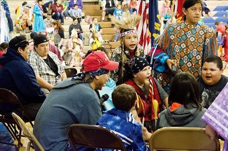 The youngest drum group at the powwow shares one of the songs they learned with the community.