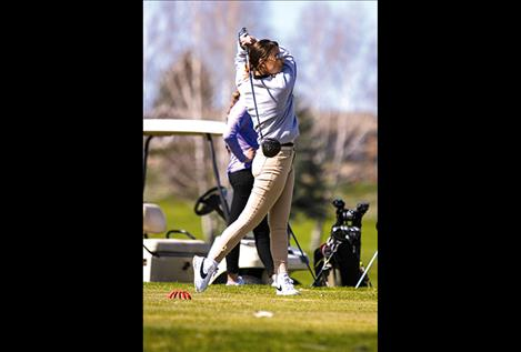 Maidens' Brooklyn Olson watches her drive during the Ronan Invitational at the Mission Mountain Golf Course on April 11.