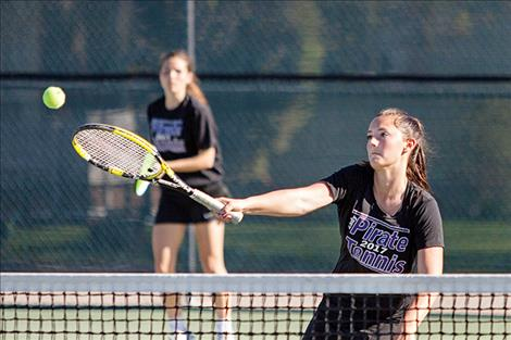 Lady Pirates' doubles team Cassie Carlyle and Kyler Lundeen enjoys a little sunshine during the match.