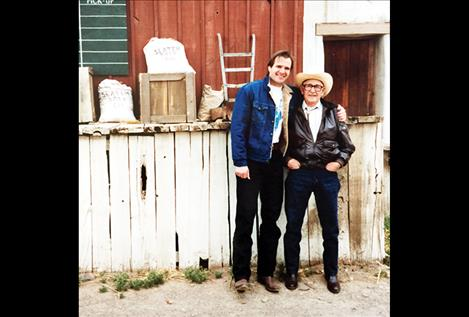 Tim Ryan Rouillier stands with his grandfather, Vic Cordier, years ago. They traveled across Montana to play music together before Cordier died on stage during a concert at the age of 93.