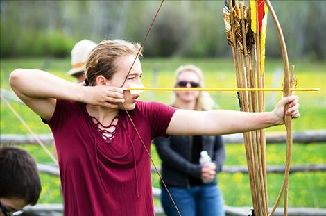 Kyla Tomlin, 14, tries the long bow set up at the event.