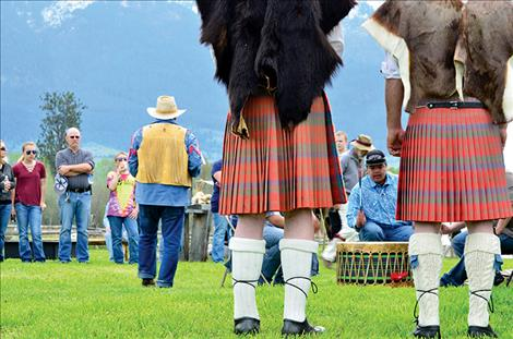 Bagpipe players listen as the Buckshot Drum group plays an